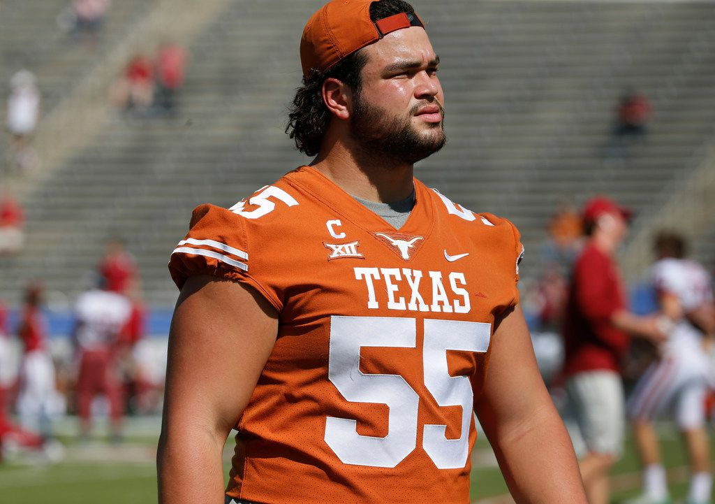 Injured Texas Longhorns offensive lineman Connor Williams (55) is pictured before the Oklahoma University Sooners vs. the University of Texas Longhorns NCAA college football game at the Cotton Bowl in Dallas on Saturday, October 14, 2017. (Louis DeLuca/The Dallas Morning News)