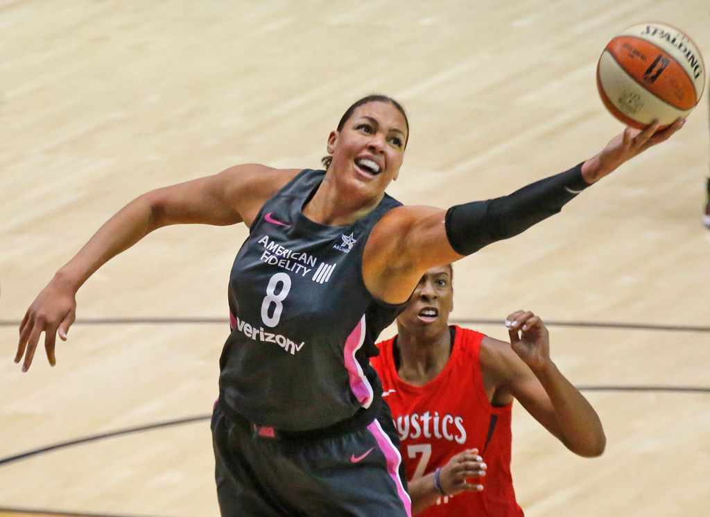 Dallas Wings center Liz Cambage (8) grabs a rebound in front of Washington Mystics guard Ariel Atkins (7) during the Dallas Wings vs. the Washington Mystics WNBA basketball game at UTA College Park Center in Arlington, Texas on Sunday, August 5, 2018. (Louis DeLuca/The Dallas Morning News)