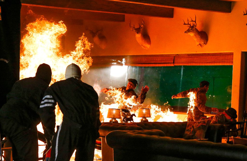 """Stuntmen are set ablaze during the filming of """"Queen of the South"""" at South Side Studios in Dallas on May 25, 2017."""