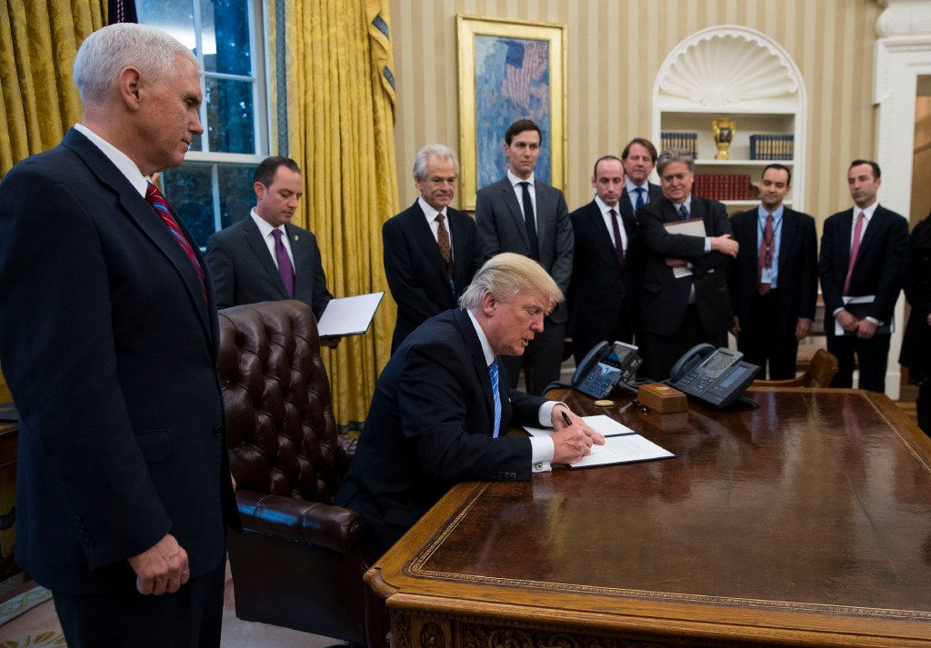 President Donald Trump signed executive orders in the Oval Office on Monday, his first weekday in office. (Doug Mills/The New York Times)
