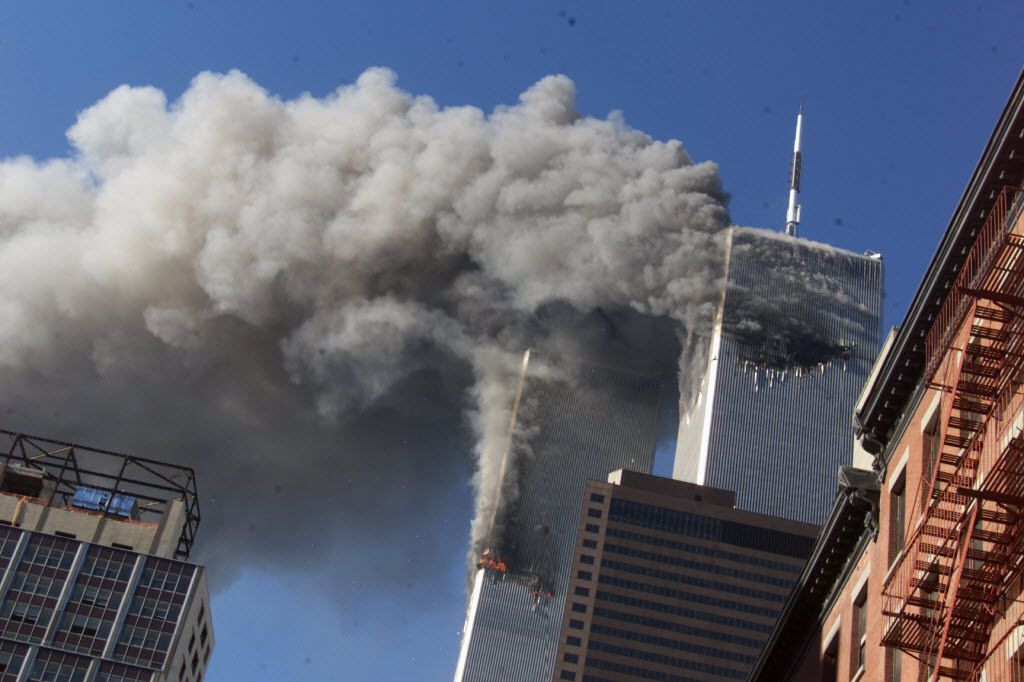 FILE - In this Sept. 11, 2001 file photo, smoke rising from the burning twin towers of the World Trade Center after hijacked planes crashed into the towers, in New York City.
