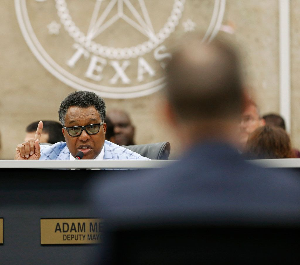 In this April 18, 2018 photo, City Council member Dwaine Caraway asks questions at Dallas City Hall in Dallas. Federal prosecutors said Caraway accepted more than $450,000 in kickbacks and bribes, in part through gambling money, trips to Las Vegas and other cities, and a phony consulting agreement. Court documents filed Aug. 9 show Caraway pleaded guilty to wire fraud and tax evasion.