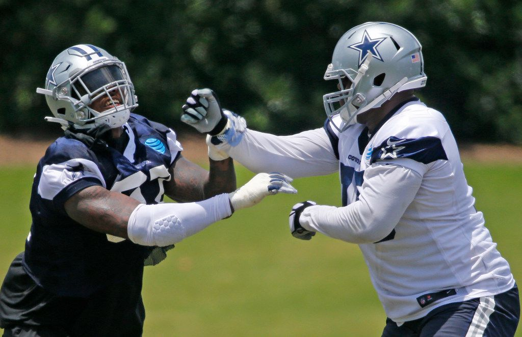 FILE - Dallas Cowboys defensive end Taco Charlton (97) squares off with offensive tackle Cameron Fleming (75) during Dallas Cowboys OTA football practice at the Star in Frisco on Wednesday, May 23, 2018. (Louis DeLuca/The Dallas Morning News)