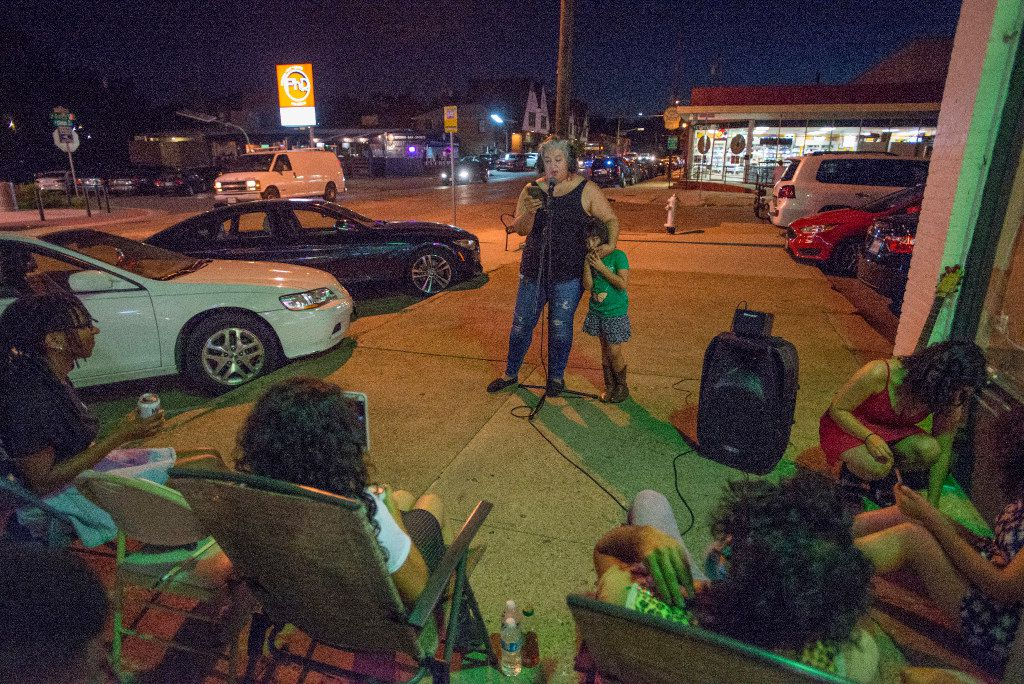 "Ofelia Faz-Garza, aka ""la Mex Mama,"" is joined by her daughter Paloma Garza during a poetry performance outside Maroches Bakery in Oak Cliff on July 28, 2017."