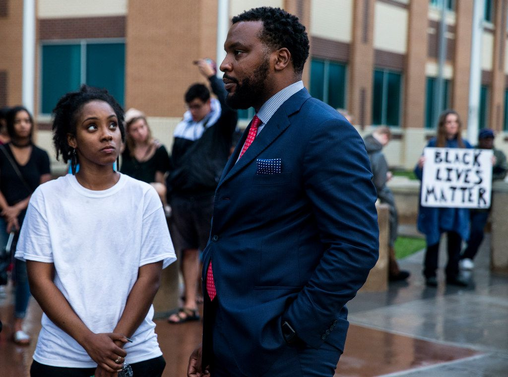 Jean family attorney Lee Merritt talks to Lelani Russell during a Next Generation Action Network protest on Friday.