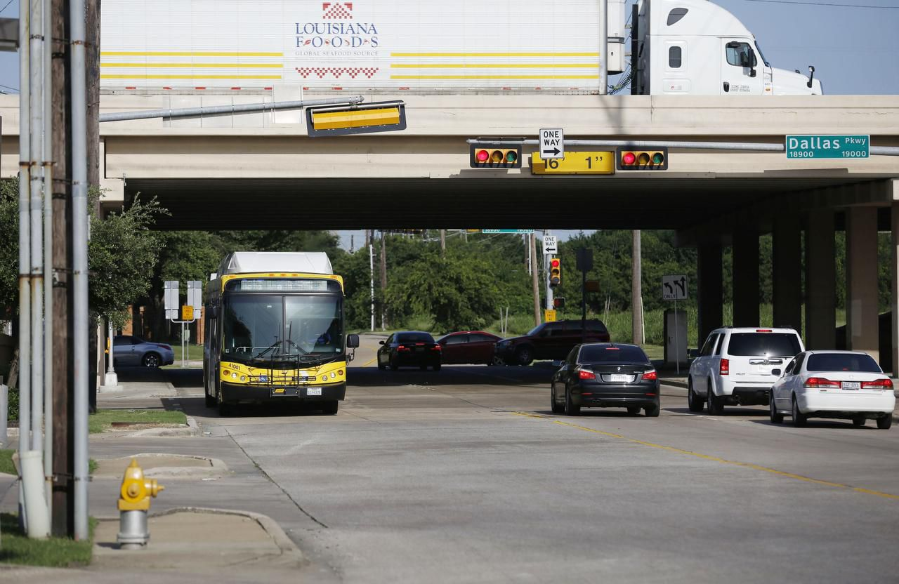 A DART 347 bus pulls up to a stop along Haverwood Lane near Dallas Parkway in Dallas.
