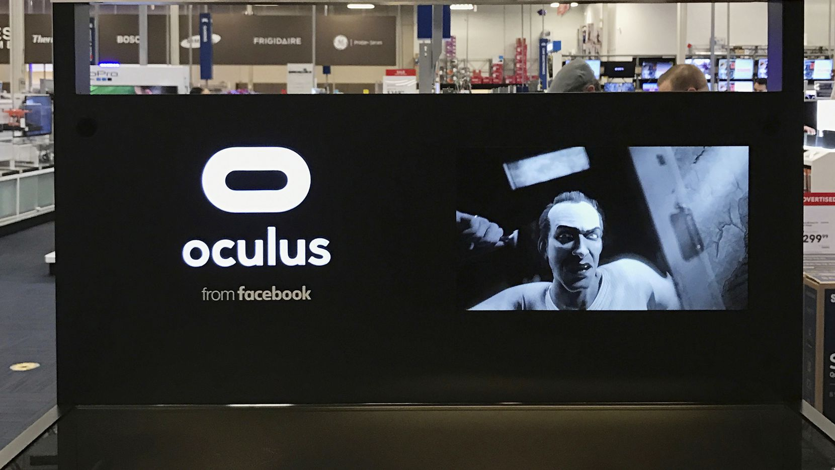 In this Jan. 3, 2017, photo a display for the new Oculus Rift virtual reality headset is showcased at a Best Buy store in Glendale, Calif.  (AP Photo/Damian Dovarganes)