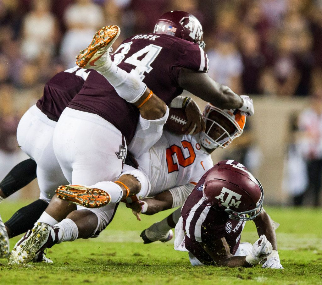 Clemson Tigers quarterback Kelly Bryant (2) is tackled by Texas A&M Aggies defensive lineman Daylon Mack (34) and defensive back Derrick Tucker (4) during the fourth quarter of a college football game between the Clemson Tigers and the Texas A&M Aggies on Saturday, September 8, 2018 at Kyle Field in College Station, Texas. (Ashley Landis/The Dallas Morning News)
