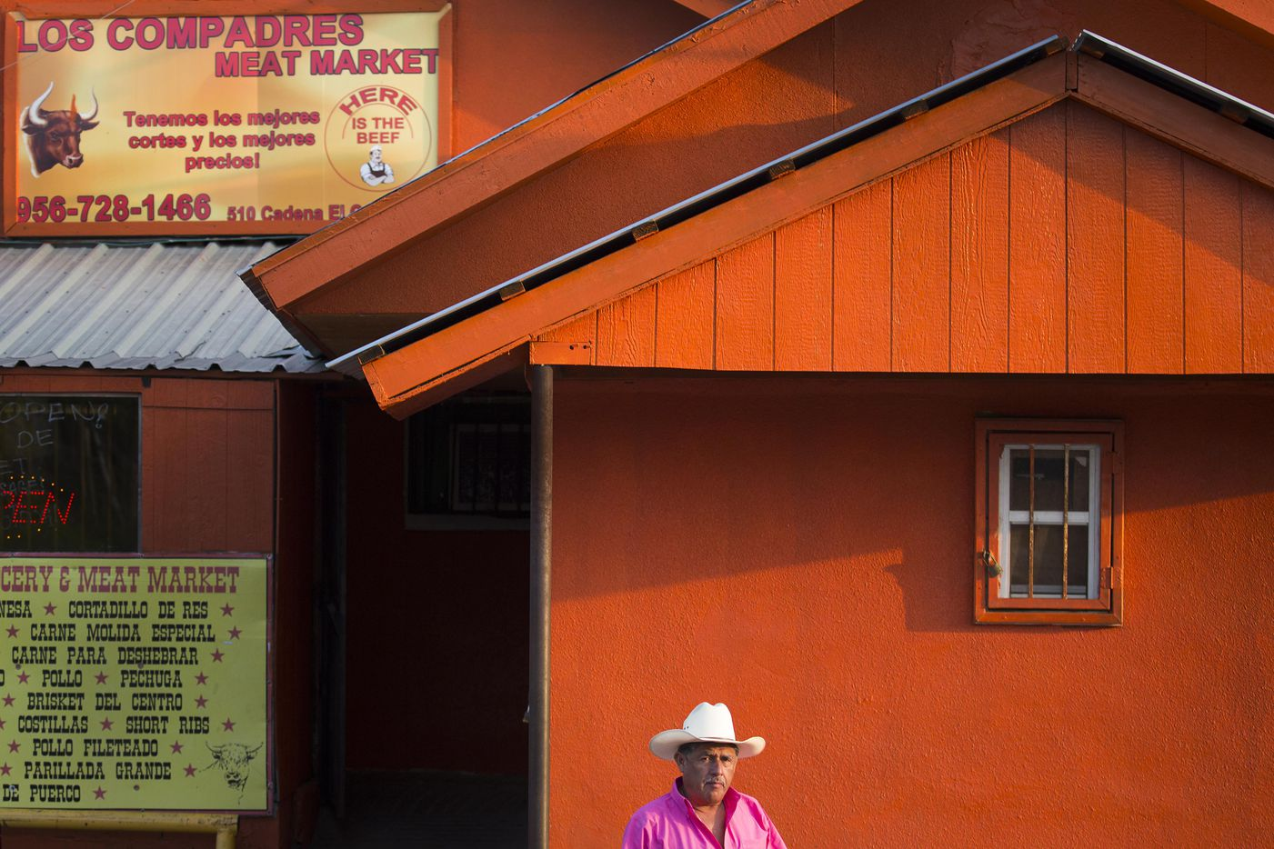 A man walks out of Los Compadres Meat Market on May 10, 2017, in El Cenizo, Texas.