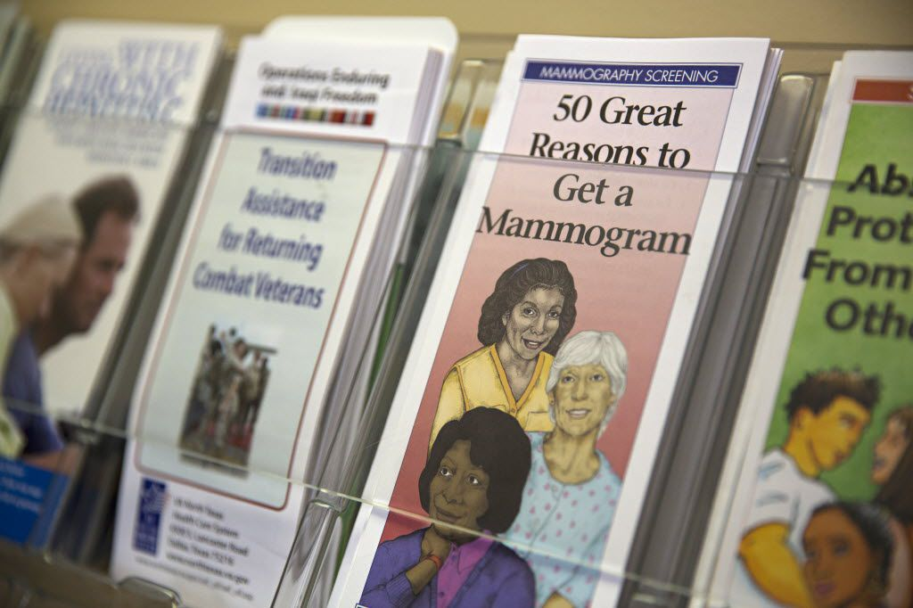 A pamphlet about mammograms sits among others on a wall display at the Urban Inter-Tribal Center of Texas. (File Photo/Staff)