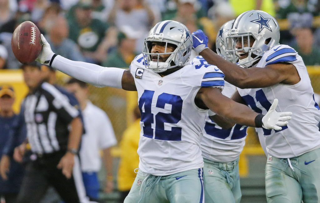 Dallas Cowboys strong safety Barry Church (42) celebrates his interception with teammates Cedric Thornton (92) and Byron Jones (31) during the Dallas Cowboys vs. the Green Bay Packers NFL football game at Lambeau Field in Green Bay, Wisconsin, on Sunday, October 16, 2016. (Louis DeLuca/The Dallas Morning News)