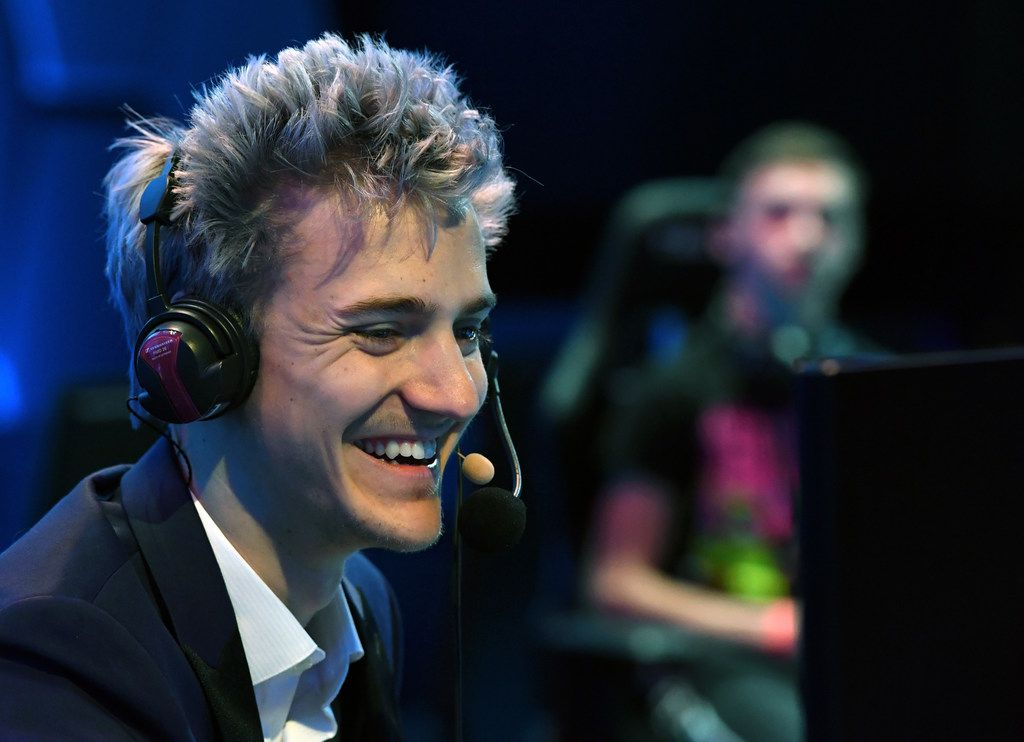 """LAS VEGAS, NV - APRIL 21:  Twitch streamer and professional gamer Tyler """"Ninja"""" Blevins streams during Ninja Vegas '18 at Esports Arena Las Vegas on April 21, 2018 in Las Vegas, Nevada. Blevins is playing against more than 230 challengers in front of 700 fans in 10 live """"Fortnite"""" games with up to USD 50,000 in cash prizes on the line. He is donating all his winnings to the Alzheimer's Association.  (Photo by Ethan Miller/Getty Images)"""