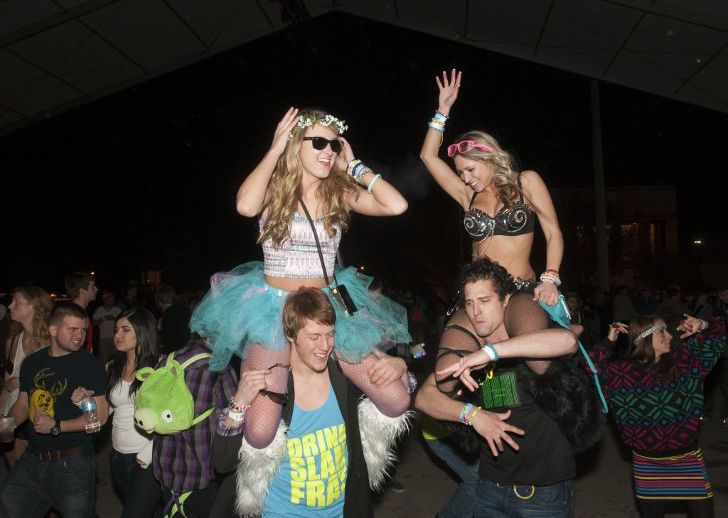 Chanse Keltner, bottom left, Stephanie Sanders, top left, Stephen Miller, bottom right, and Jamie Fife dance during the Lights All Night NYE Dance Party at Fair on Saturday, Dec. 29, 2012.   (Rex C. Curry/Special Contributor)