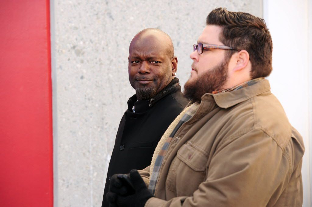 In this photo provided by CBS, former NFL player Emmitt Smith, left, looks towards actor Charley Koontz on the set of CSI: Cyber in Los Angeles. While the NFL's career rushing leader has long dazzled fans with his fancy footwork on and off the field, he didn't have to do much dancing to find a fitting role -- playing himself in a cameo appearance on Sunday night's CBS episode of CSI: Cyber. (Ron P. Jaffe/CBS via AP)