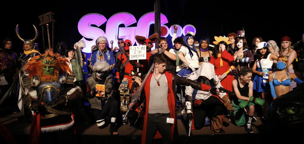Video game and cartoon characters pose for a group shot following the SGC cosplay contest.