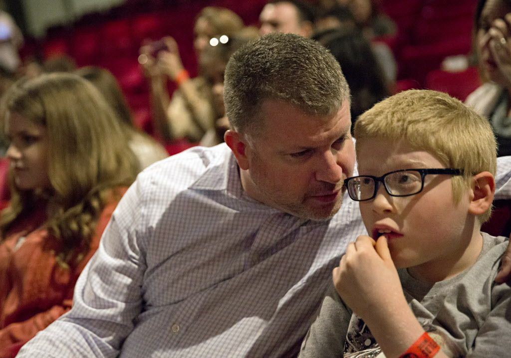 "Rob Schneider (left) talks to his son, Ben, as they listen to musician Ben Folds perform a sound check at the Majestic Theater Thursday, April 14, 2016 in Dallas. Schneider, 11, who is both blind and autistic, learned to play Folds' song ""Sky High"" and considers the musician a hero. He was given the chance to meet Folds during an event for VIP's before his show Thursday night at the downtown Dallas venue. (G.J. McCarthy/The Dallas Morning News)"