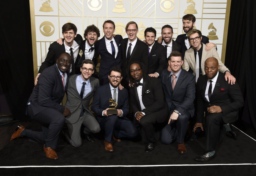 "Snarky Puppy & Metropole Orkest pose in the press room with the award for best contemporary instrumental album for ""Sylva"" at the 58th annual Grammy Awards at the Staples Center on Monday, Feb. 15, 2016, in Los Angeles."