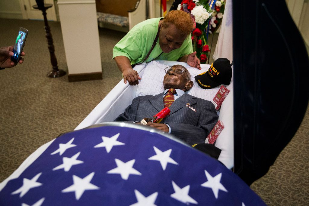 Ryan Ward takes a photo of Patricia Ward and the remains of Richard Overton at Cook-Walden Funeral Home in Austin on Friday, Jan. 11, 2019, the day before his funeral service and burial. Overton was the oldest living veteran and oldest living male at 112 years old until he died on Dec. 27, 2018. He was known for drinking whiskey and smoking cigars on his front porch in East Austin.