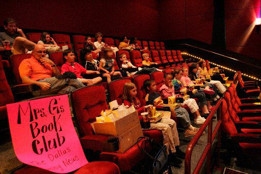 "In 2004, participants in Mrs. G's Book Club from ""The Dallas Morning News"" prepared to watch the movie ""Ella Enchanted"", which was a book club selection,  at the new AMC theater."