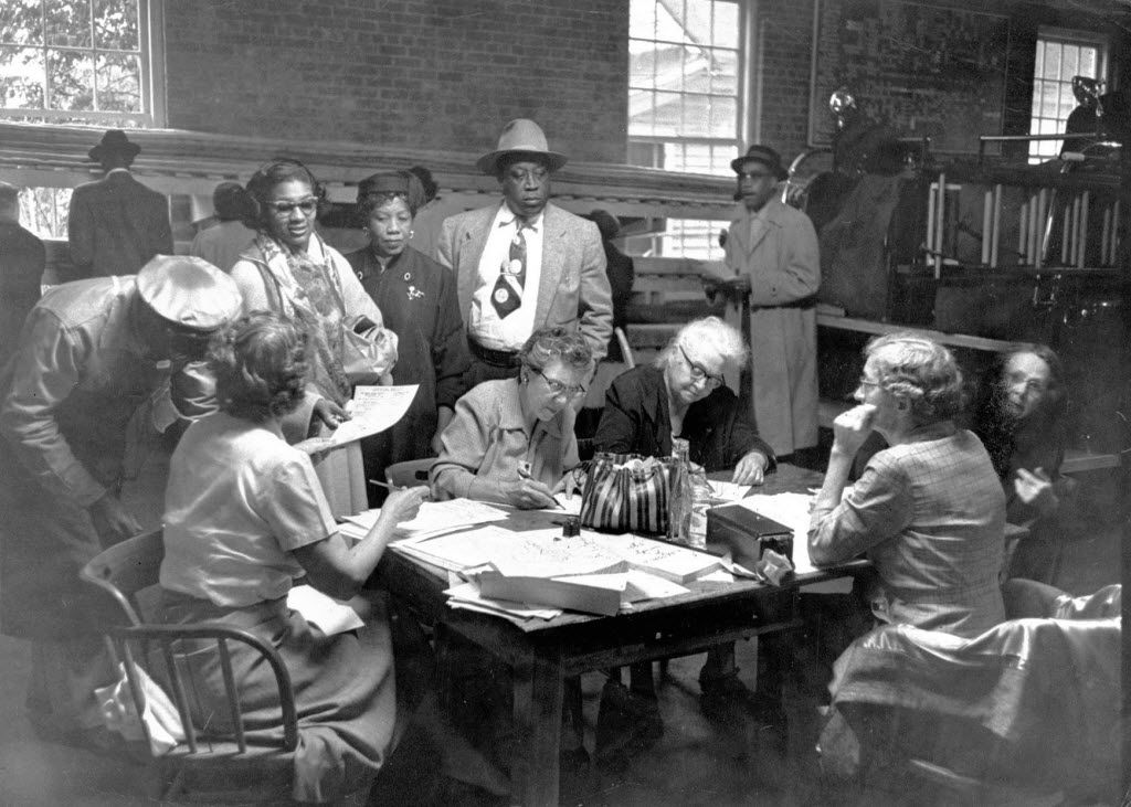 Voters cast ballots at a polling station in a firehouse, after black people were granted the right to vote as part of the 1957 Civil Rights Act, in Little Rock in November of 1957.