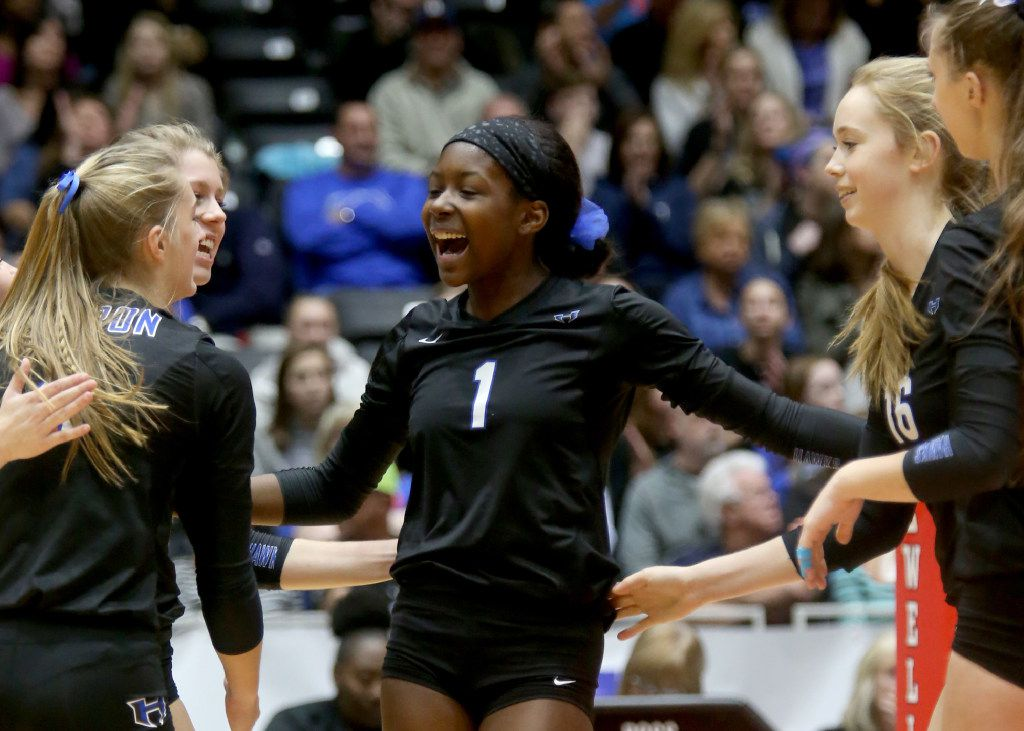 Hebron's Adanna Rollins (1) is all smiles after a ace in Class 6A Volleyball State Championship against Clear Creek, Saturday, November 19, 2016 at the Curtis Culwell Center in Garland. (Rick Moon/Special contributor)