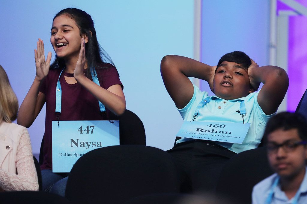 Naysa Modi (left) of Frisco and Rohan Raja of Irving react to the news that they have advanced to the final rounds of the 91st Scripps National Spelling Bee in 2018 in National Harbor, Md. Forty-one finalists were selected to participate in the final day after a record 516 spellers were officially invited, up from 291 in 2017.