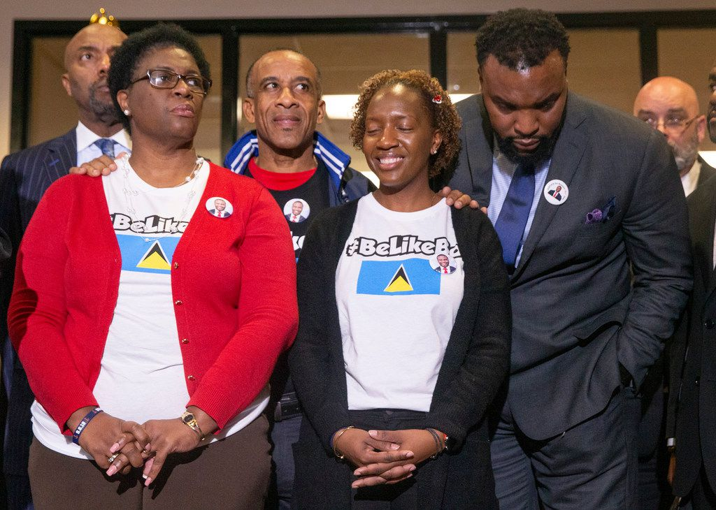 Allison Jean, Botham Shem Jean's mother, left listens along with Bertrum Jean, Botham Jean's father, Allisa Findley, Botham Jean's sister and the family's lawyer Lee Merritt, right during a press conference after Amber Guyger was indicted for murder on Nov. 30, 2018.