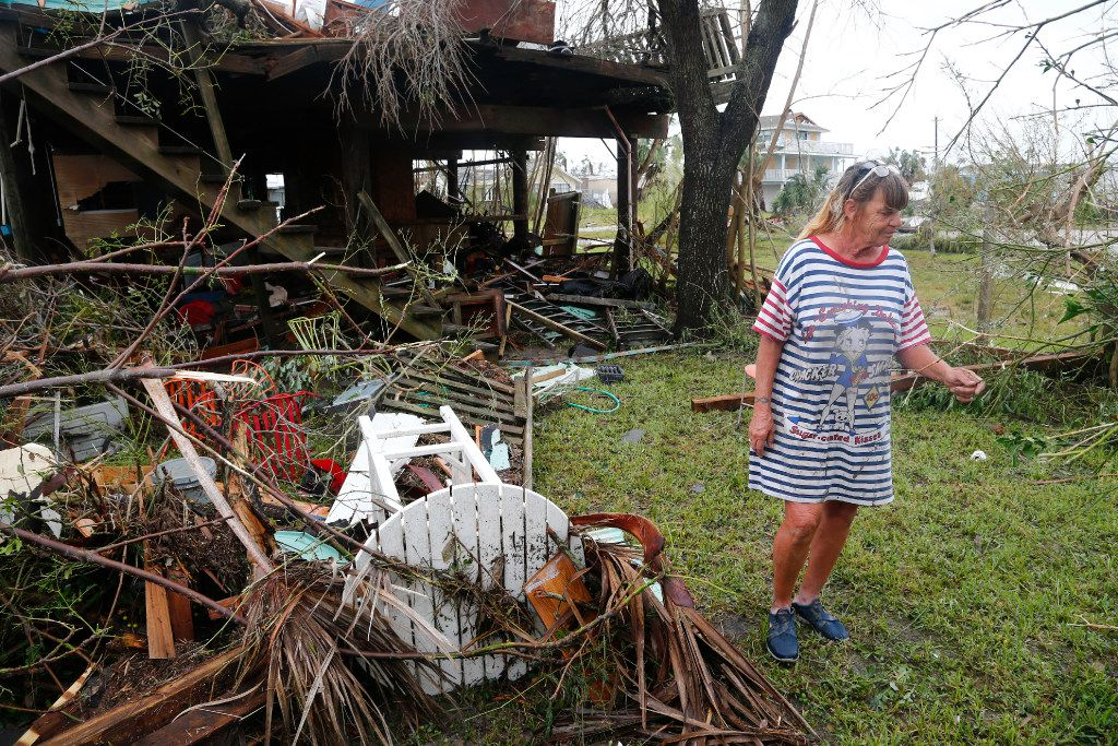 Paulette Rogers looks at her destroyed pineapple tree after Hurricane Harvey destroyed their house in Port Aransas, Texas on Aug. 26, 2017.   (Nathan Hunsinger/The Dallas Morning News)