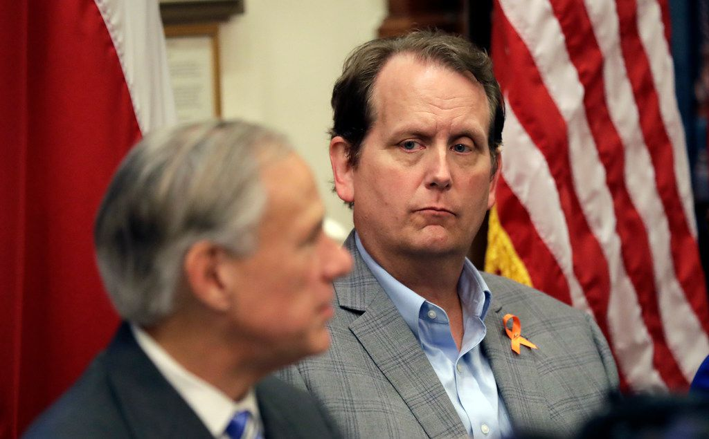 Ed Scruggs, Board Vice-Chair of Texas Gun Sense – Advocacy group that promotes common sense, right, listens to Texas Gov. Gregg Abbott, left, during a roundtable discussion to address safety and security at Texas schools in the wake of the shooting at Santa Fe, at the state Capitol in Austin, Texas, Wednesday, May 23, 2018. Abbott, a Republican who has worked to expand gun rights in the state, called for the meetings as he weighs ideas for possible legislative action or executive orders. Two dozen groups were invited to attend the session, which was expected to include conversations on monitoring students' mental health. (AP Photo/Eric Gay)