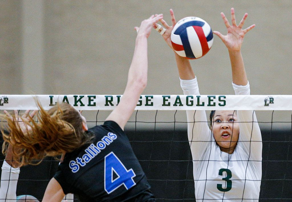 Mansfield Lake Ridge junior Kaelyn Mack (3) attempts to block a spike by North Mesquite senior Lena Cates (4) during a high school volleyball game at Mansfield Lake Ridge High school in Mansfield, Tuesday, August 27, 2019. Lake Ridge won in three sets. (Brandon Wade/Special Contributor)
