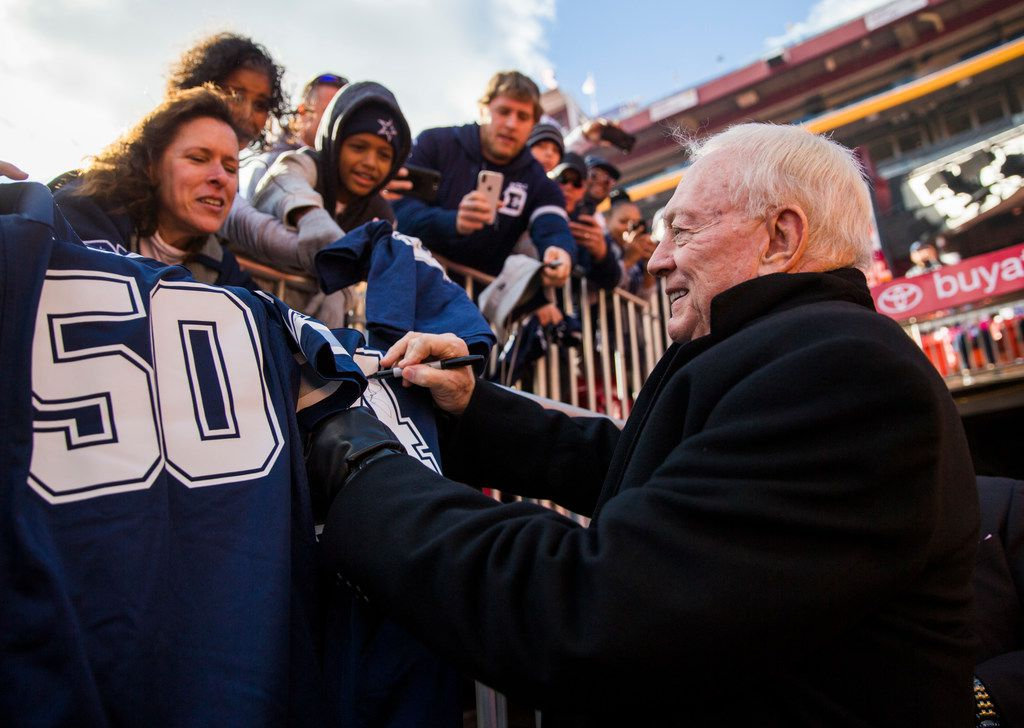 Cowboys owner Jerry Jones signs autographs for fans before a game against the Washington Redskins on Sunday, Oct. 21, 2018, in Landover, Md. (Ashley Landis/The Dallas Morning News)