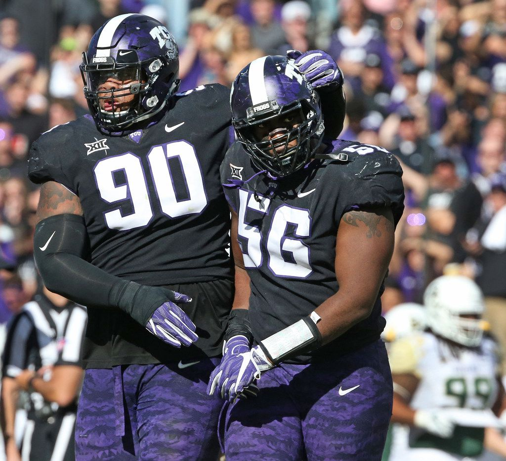 TCU Horned Frogs defensive tackles Ross Blacklock (90) and Chris Bradley (56) walk off the field together after an altercation on the Baylor sidelines in the second half during the Baylor University Bears vs. the TCU Horned Frogs NCAA college football game at Amon G. Carter Stadium in Fort Worth, Texas on Friday, November 24, 2017. (Louis DeLuca/The Dallas Morning News)