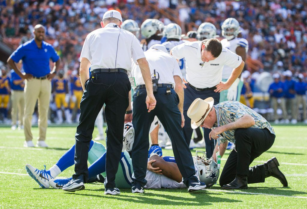 Dallas Cowboys linebacker Chris Covington (59) lays hurt on the field during the first quarter of an NFL preseason game between the Dallas Cowboys and the Los Angeles Rams on Friday, August 17, 2019 at Aloha Stadium in Honolulu, Hawaii. (Ashley Landis/The Dallas Morning News)