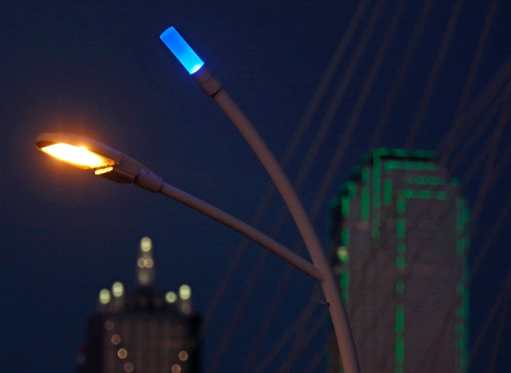Blue LEDs sit atop the streetlights around the Trinity River at the Ronald Kirk Pedestrian Bridge in downtown Dallas.