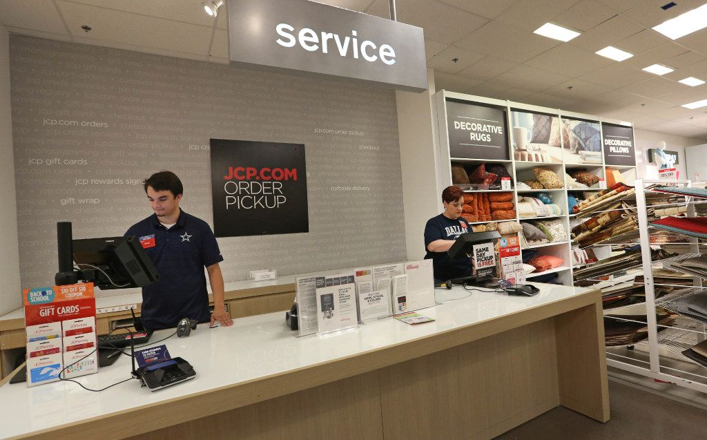 Rhett Biehahn (left) and Tami Doss work Penney's pickup counter for online purchases at the J.C. Penney store at Stonebriar Centre in Frisco.