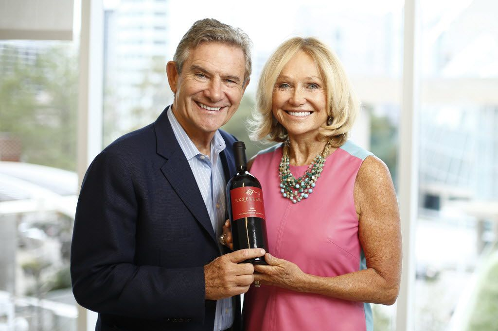 Craig and Kathryn Hall pose with a bottle of an award-winning bottle of Hall wine. (Ting Shen/The Dallas Morning News)