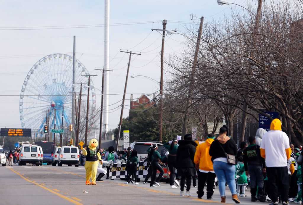 People make their way through Martin Luther King Jr. Blvd during the  during the 37th Annual MLK Parade in Dallas on Saturday, January 21, 2019. (Vernon Bryant/The Dallas Morning News)