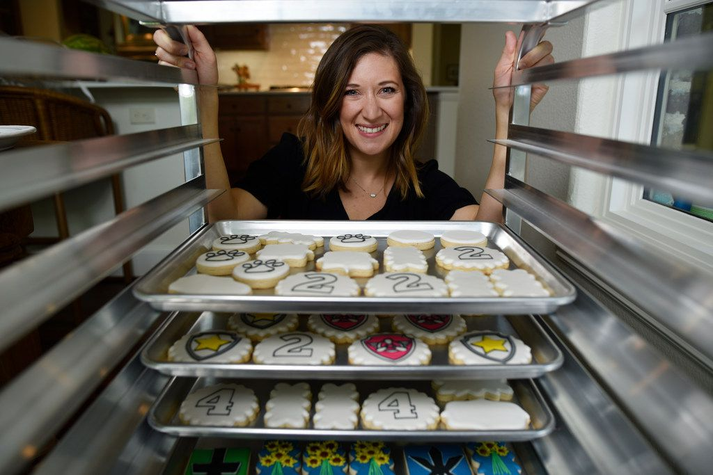 Cale Pruit of Tesoro Baking Co. with several trays of cookies she baked and decorated at her home in Dallas on June 13, 2019.