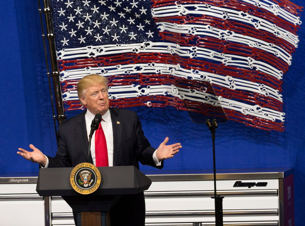 """President Donald Trump signed the """"Buy American and Hire American"""" executive order Tuesday during a visit to Snap-on Inc. in Kenosha, Wis. The order clamps down on guest-worker visas and requires federal agencies to buy more goods and services from U.S. companies. (Mark Hoffman/Milwaukee Journal Sentinel)"""
