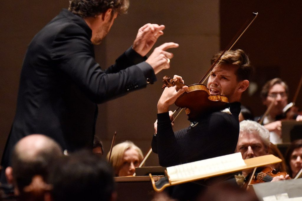 Violinist Blake Pouliot (right) and conductor Pablo Heras-Casado warmly shaped the Brahms Violin Concerto's more melodic parts and daringly stretched major transitions without overdoing them.
