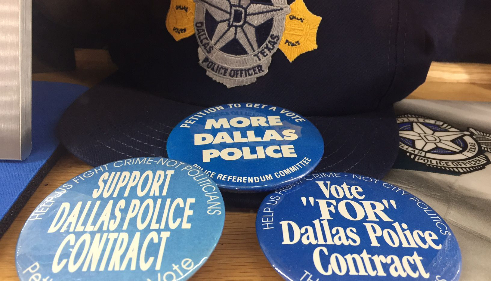 Buttons on display at the Dallas Police Association's headquarters reveal some of the longstanding feelings about what the association says City Hall needs to do for officers. (Tristan Hallman/Staff)