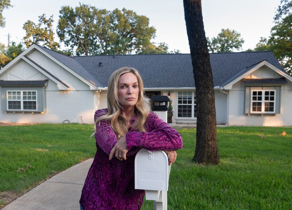 Lauren Alvarez says her travails with a Texas concrete company illustrate how difficult it can be to find a reliable home contractor. Along with her husband, she's a professional house flipper. Here, she stands in front of her renovated Colleyville home.