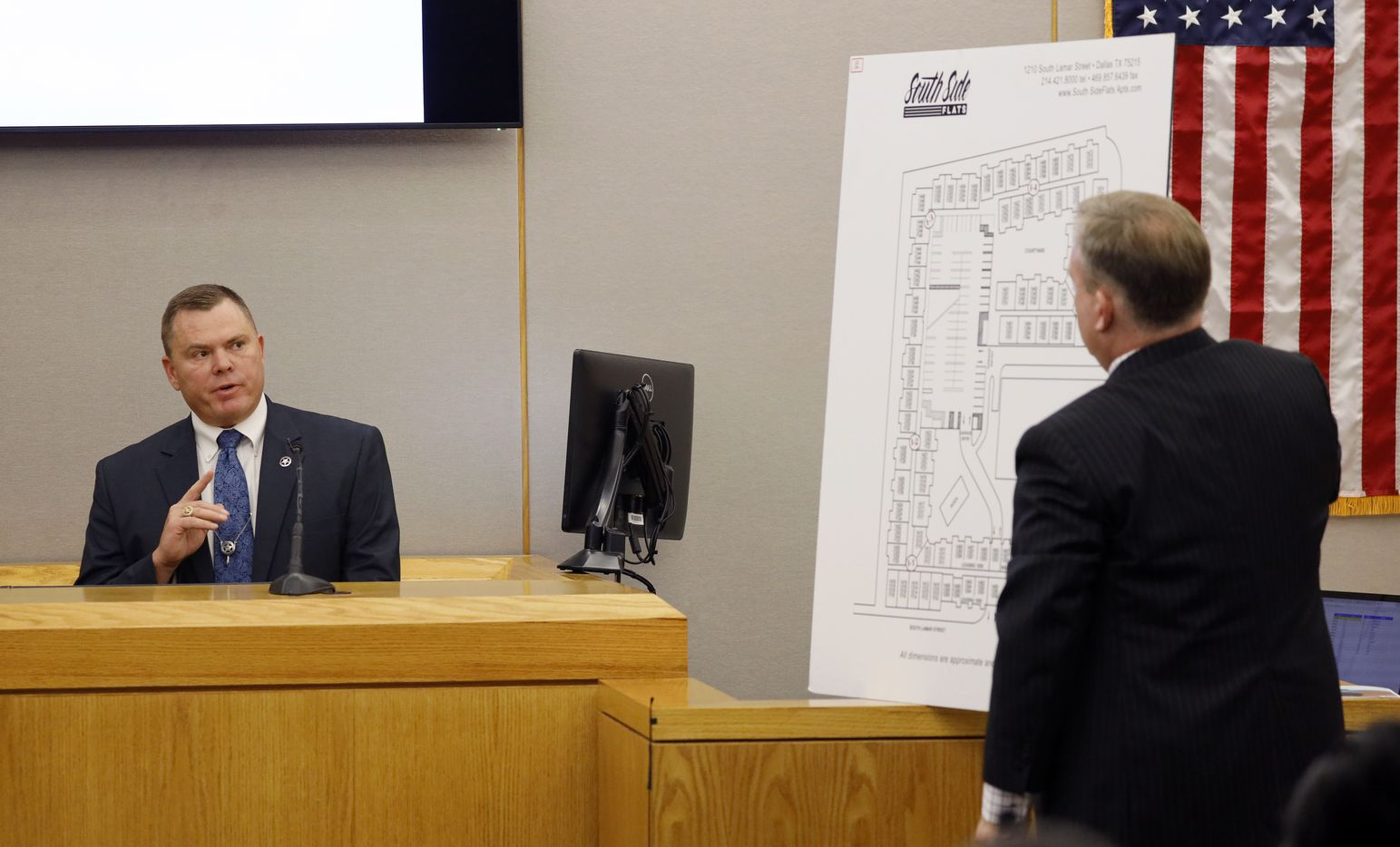 Assistant District Attorney Jason Hermus (right) questions Texas Ranger Michael Stoner on the witness stand during the morning session. Fired Dallas police Officer Amber Guyger is facing a murder charge in the 204th District Court at the Frank Crowley Courts Building in Dallas, Thursday, September 26, 2019.