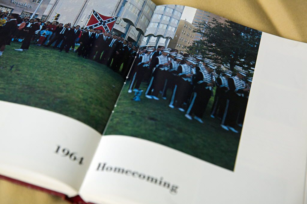 A yearbook from Midland Lee High School shows students during the 1964 homecoming parade holding a Confederate flag.