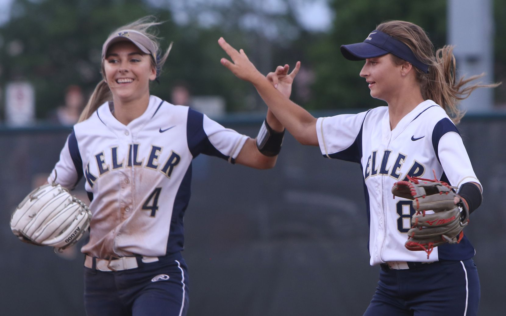 Keller outfielders Amanda Desario (4) and Brook Davis (8) celebrates Davis' catch in right field of a fly ball to end the bottom of the second inning of play against Austin Bowie. The two teams competed in the Class 6A state softball championship game at McCombs Field in Austin on June 3, 2017. (Steve Hamm/Special Contributor)