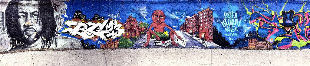 The tour takes visitors by colorful street art that adorns neighborhood walls.
