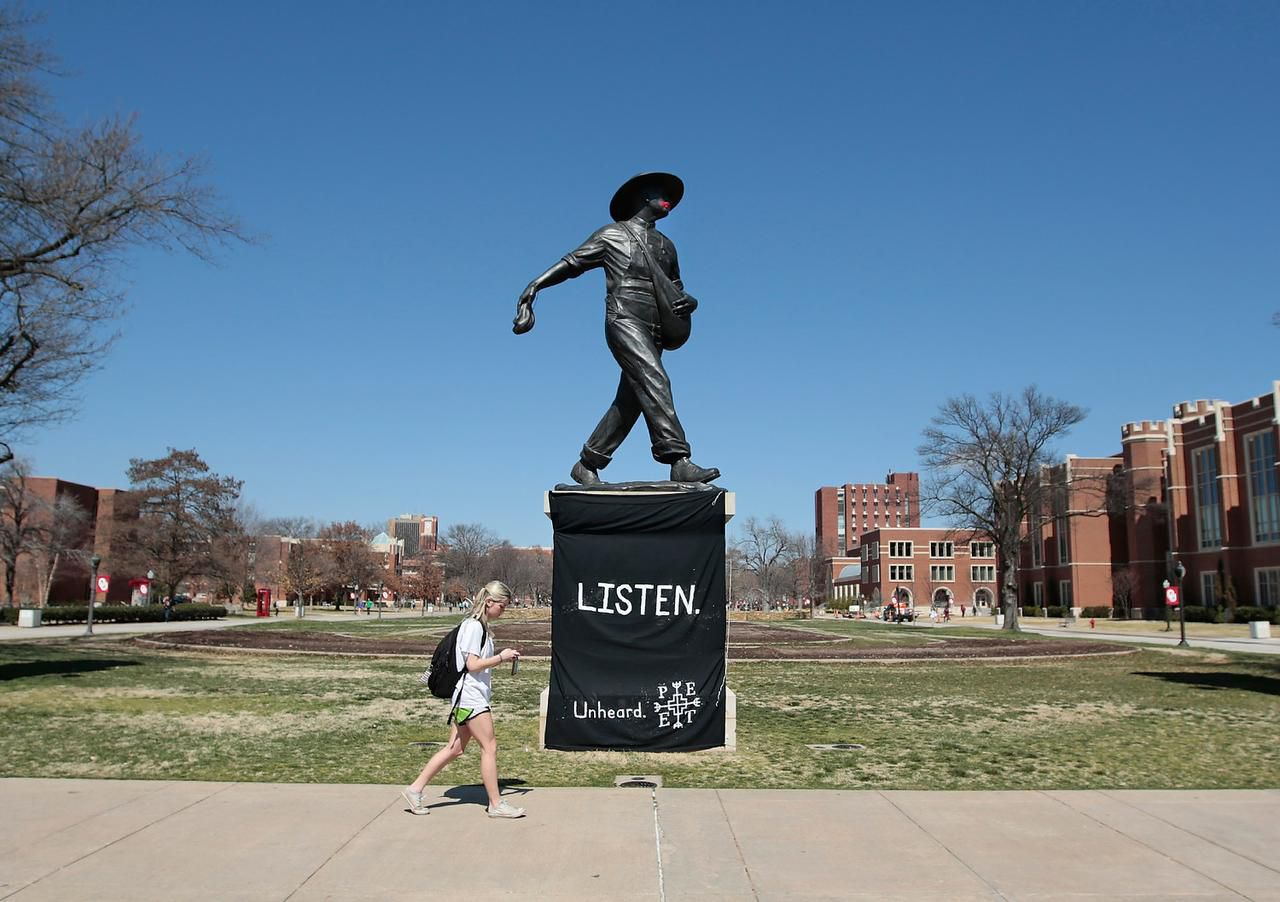 The sculpture The Sower on the University of Oklahoma campus in Norman was draped with a sign last week by the student group OU Unheard.