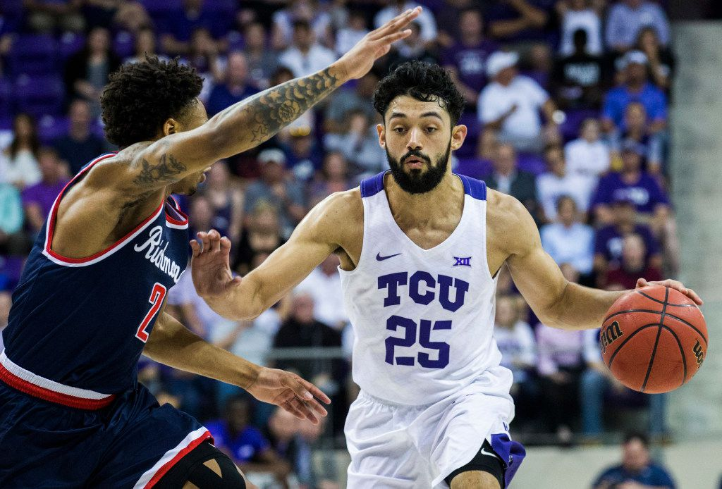 TCU Horned Frogs guard Alex Robinson (25) makes his way around Richmond Spiders guard Khwan Fore (2) during the first half of an NIT quarterfinal game between TCU and University of Richmond on Tuesday, March 21, 2017 at the Ed & Rae Schollmaier Arena in Fort Worth. (Ashley Landis/The Dallas Morning News)