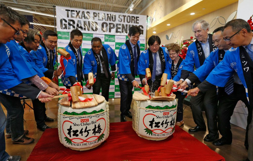 Mituwa managers, and business owners open the ceremonial sake barrels during the grand opening of the Mitsuwa Market place in Plano, Texas on April 14, 2017. (Nathan Hunsinger/The Dallas Morning News)