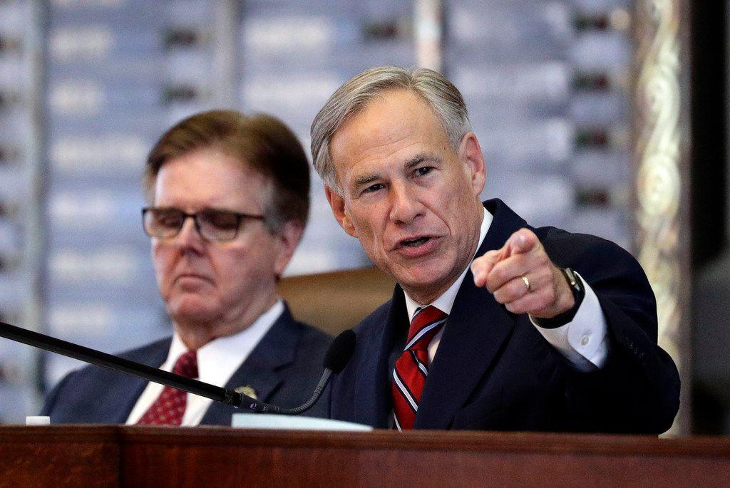 Texas Gov. Greg Abbott (right) speaks during his 2019 State of the State address as Lt. Gov. Dan Patrick (left) listens in the House Chamber in Austin.